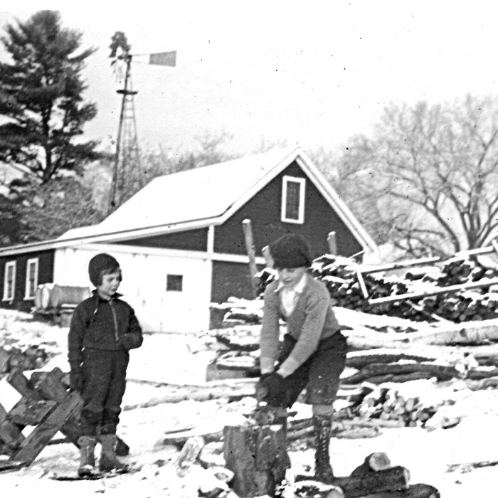 Ruth and Rebecca splitting wood, 1933