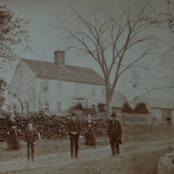 Henry A. Towne, his wife and family standing on Towne Road.