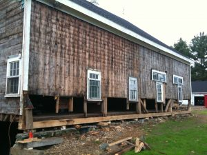The restoration of the ifarm barn. Notice the relatively few load-bearing posts along the wall.
