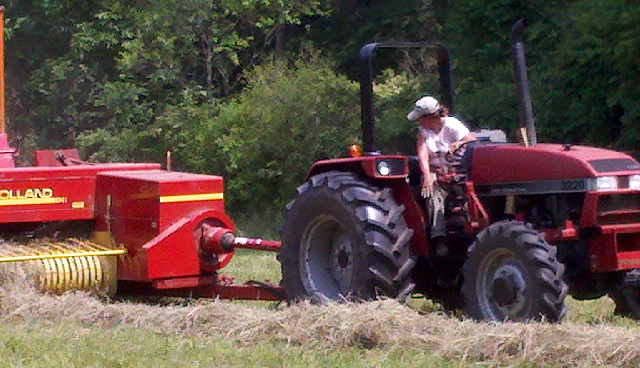 Chris out on the tractor haying a field