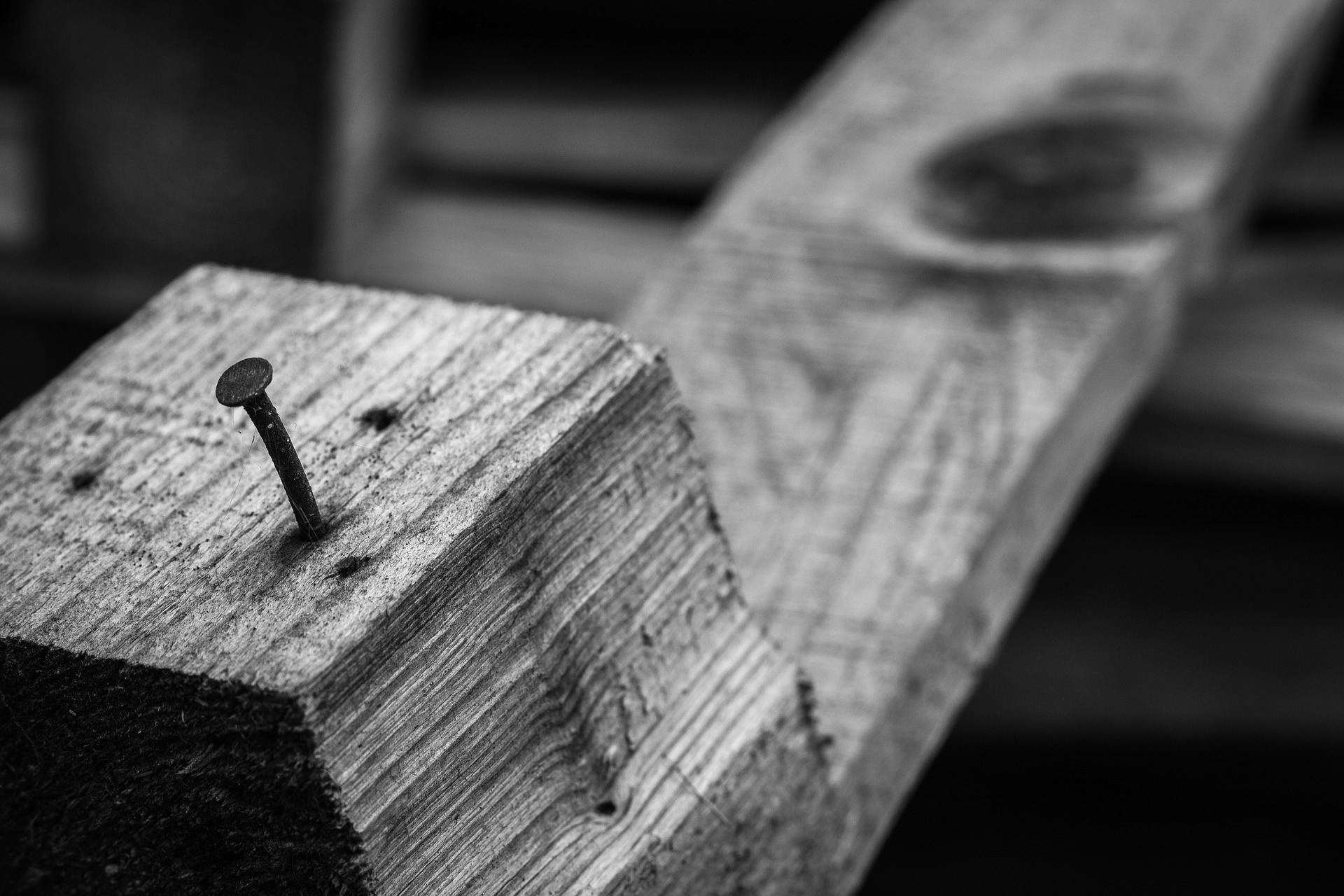 Wooden board with nail